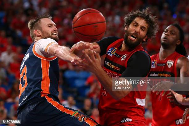 Mark Worthington of the Taipans and Matt Knight of the Wildcats contest for a loose ball during the game two NBL Semi Final match between the Perth...