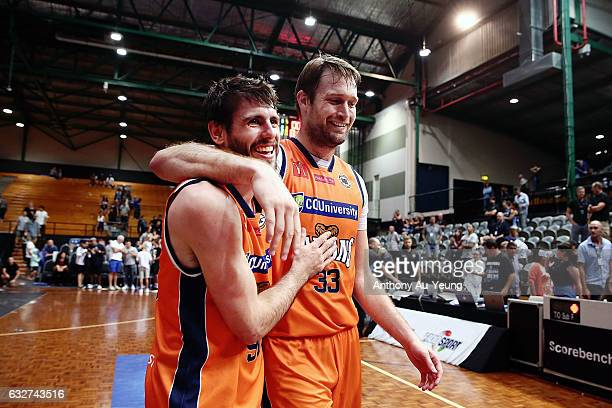 Mark Worthington of the Taipans is congratulated by teammate Jarrad Weeks after winning the round 17 NBL match between the New Zealand Breakers and...