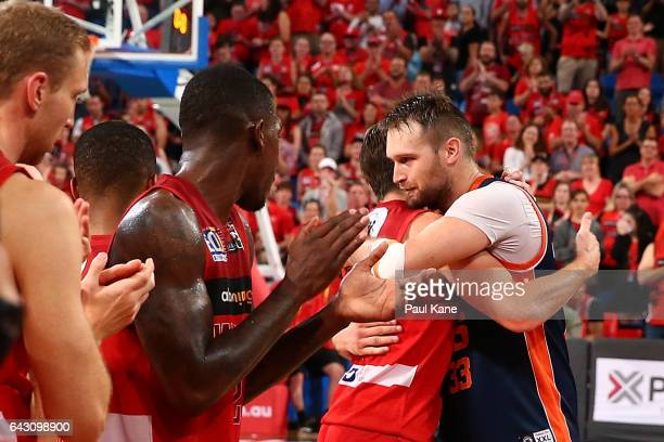 Mark Worthington of the Taipans is embraced by Damian Martin of the Wildcats after playing his final game during the game two NBL Semi Final match...