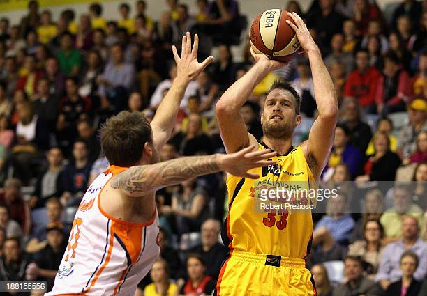 Mark Worthington of the Tigers drives to the basket during the round six NBL match between the Melbourne Tigers and the Cairns Taipans at State...
