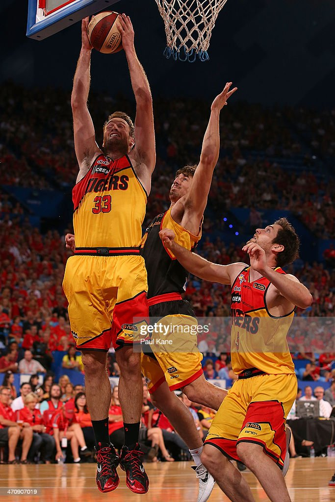Mark Worthington of the Tigers pulls down a rebound during the round 19 NBL match between the Perth Wildcats and the Melbourne Tigers at Perth Arena on February 21, 2014 in Perth, Australia.