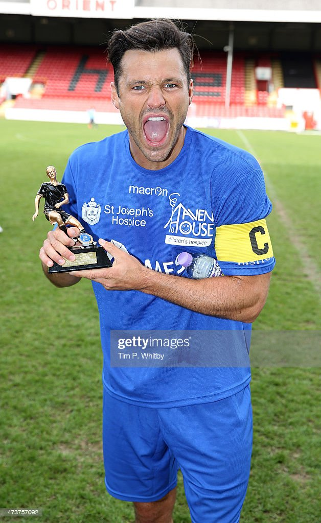 Mark Wright with his 'Man of the Match' trophy at a Charity football match in aid of St Joseph's Hospice and Haven House Children's Hospice at Leyton Orient Matchroom Stadium on May 17, 2015 in London, England.
