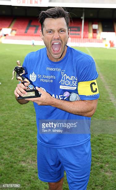 Mark Wright with his 'Man of the Match' trophy at a Charity football match in aid of St Joseph's Hospice and Haven House Children's Hospice at Leyton...