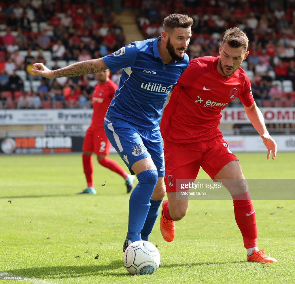 Mark Yeates of Eastleigh and Craig Clay of Leyton Orient compete for the ball during the National League match between Leyton Orient and Eastleigh at The Matchroom Stadium on August 26, 2017 in London, United Kingdom.