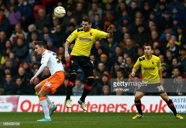 Mark Yeates of Watford and Matt Derbyshire of Blackpool challenge for the arial ball during the npower Champions match between Watford and Blackpool...