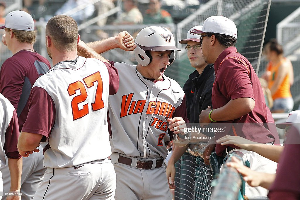 Mark Zagunis #2 of the Virginia Tech Hokies celebrates as he comes back to the dugout after scoring the lead run against the Miami Hurricanes in the top of the tenth inning on March 24, 2013 at Alex Rodriguez Park at Mark Light Field in Coral Gables, Florida. Virginia Tech defeated Miami 8-5 in 10 innings.