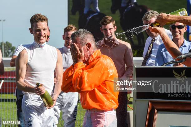 Mark Zahra and Damien Oliver shower Darren Gauci in champagne after riding his last race at Caulfield Racecourse on February 04 2017 in Caulfield...