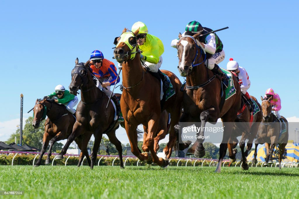 Mark Zahra riding He Or She defeats Dwayne Dunn riding Hooked in Race 6 during Melbourne Racing at Flemington Racecourse on March 4, 2017 in Melbourne, Australia.