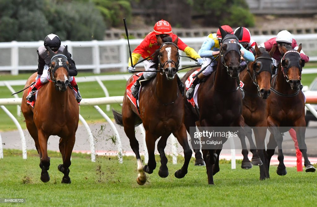 Mark Zahra riding Russian Revolution defeats Damian Lane riding Heatherly and Craig Williams riding Houtzen (L) in Race 5, Mitty's McEwen Stakes during Melbourne Racing at Moonee Valley Racecourse on September 9, 2017 in Melbourne, Australia.