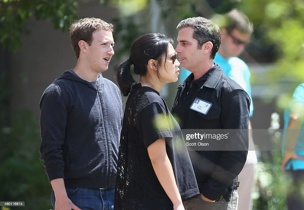 Mark Zuckerberg (L), chief executive officer and founder of Facebook Inc.and his wife Priscilla Chan chat with Dan Rose, VP of Business Development and Monetization at Facebook, at the Allen & Company Sun Valley Conference on July 9, 2015 in Sun Valley, Idaho. Many of the worlds wealthiest and most powerful business people from media, finance, and technology attend the annual week-long conference which is in its 33rd year.