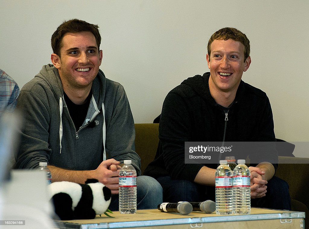 Mark Zuckerberg, chief executive officer and founder of Facebook Inc., right, and Chris Struhar, tech lead of Facebook Inc., smile during an event at the company's headquarters in Menlo Park, California, U.S., on Thursday, March 7, 2013. Zuckerberg discussed the social-network site's upgraded News Feed which includes bigger photos, information sorted into topics and a more consistent design across devices. Photographer: David Paul Morris/Bloomberg via Getty Images