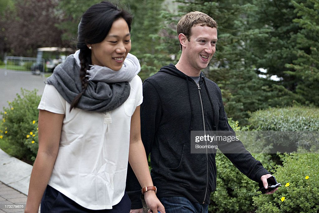 <a gi-track='captionPersonalityLinkClicked' href=/galleries/search?phrase=Mark+Zuckerberg&family=editorial&specificpeople=4841191 ng-click='$event.stopPropagation()'>Mark Zuckerberg</a>, chief executive officer and founder of Facebook Inc., walks with his wife <a gi-track='captionPersonalityLinkClicked' href=/galleries/search?phrase=Priscilla+Chan&family=editorial&specificpeople=4125446 ng-click='$event.stopPropagation()'>Priscilla Chan</a> while arriving for a morning session during the Allen & Co. Media and Technology Conference in Sun Valley, Idaho, U.S., on Thursday, July 11, 2013. Executives from media, finance and politics mingle at the mountain resort between presentations on business trends and social issues, brought together by New York investment banker Herb Allen. Photographer: Daniel Acker/Bloomberg via Getty Images