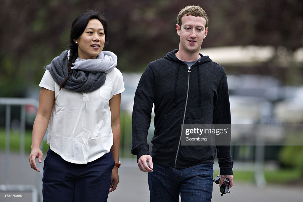 Mark Zuckerberg, chief executive officer and founder of Facebook Inc., walks with his wife Priscilla Chan while arriving for a morning session during the Allen & Co. Media and Technology Conference in Sun Valley, Idaho, U.S., on Thursday, July 11, 2013. Executives from media, finance and politics mingle at the mountain resort between presentations on business trends and social issues, brought together by New York investment banker Herb Allen. Photographer: Daniel Acker/Bloomberg via Getty Images