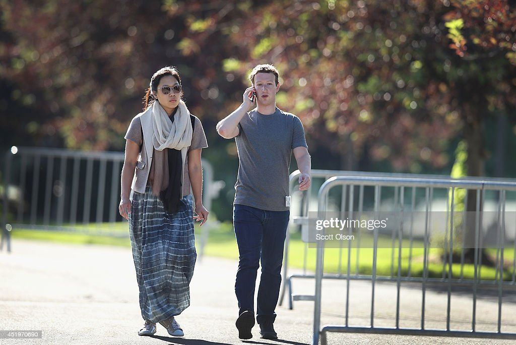 <a gi-track='captionPersonalityLinkClicked' href=/galleries/search?phrase=Mark+Zuckerberg&family=editorial&specificpeople=4841191 ng-click='$event.stopPropagation()'>Mark Zuckerberg</a>, chief executive officer and founder of Facebook Inc., and his wife <a gi-track='captionPersonalityLinkClicked' href=/galleries/search?phrase=Priscilla+Chan&family=editorial&specificpeople=4125446 ng-click='$event.stopPropagation()'>Priscilla Chan</a> attend the Allen & Company Sun Valley Conference on July 10, 2014 in Sun Valley, Idaho. Many of the world's wealthiest and most powerful businessmen from media, finance, and technology attend the annual week-long conference which is in its 32nd year.