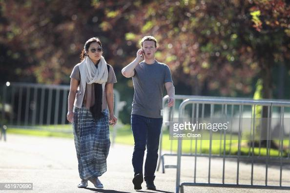 Mark Zuckerberg chief executive officer and founder of Facebook Inc and his wife Priscilla Chan attend the Allen Company Sun Valley Conference on...