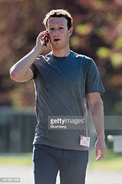 Mark Zuckerberg chief executive officer and founder of Facebook Inc talks on the phone while arriving for a morning session at the Allen Co Media and...