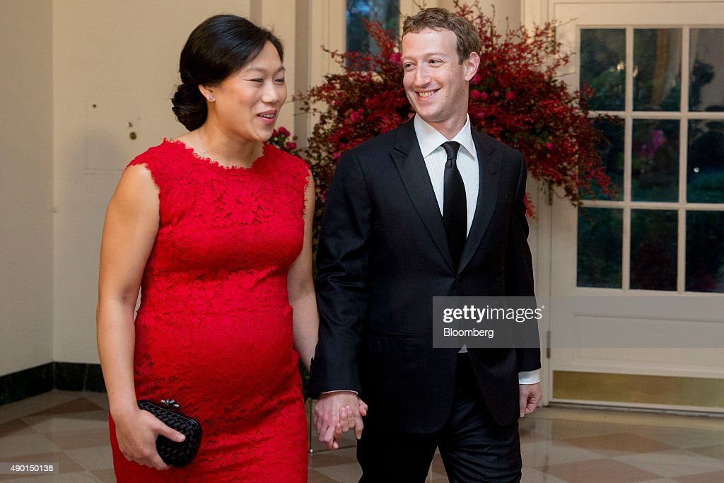 Mark Zuckerberg, chief executive officer and founder of Facebook Inc., right, and his wife Priscilla Chan arrive at a state dinner in honor of Chinese President Xi Jinping at the White House in Washington, D.C., U.S., on Friday, Sept. 25, 2015. The U.S. and China announced agreement on broad anti-hacking principles aimed at stopping the theft of corporate trade secrets though President Barack Obama pointedly said he has not ruled out invoking sanctions for violators. Photographer: Andrew Harrer/Bloomberg via Getty Images