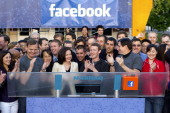 Mark Zuckerberg chief executive officer of Facebook Inc center Sheryl Sandberg chief operating officer of Facebook center left and Robert Greifeld...