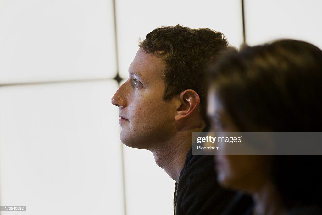 Mark Zuckerberg, chief executive officer of Facebook Inc., left, and Sheryl Sandberg, chief operating officer of Facebook Inc., watch a presentation during an event at the company's headquarters in Menlo Park, California, U.S., on Thursday, June 20, 2013. Facebook Inc., operator of the largest social network, plans to unveil video-sharing tools, bringing its Instagram into closer competition with Twitter Inc., a person with knowledge of the matter said. Photographer: David Paul Morris/Bloomberg via Getty Images