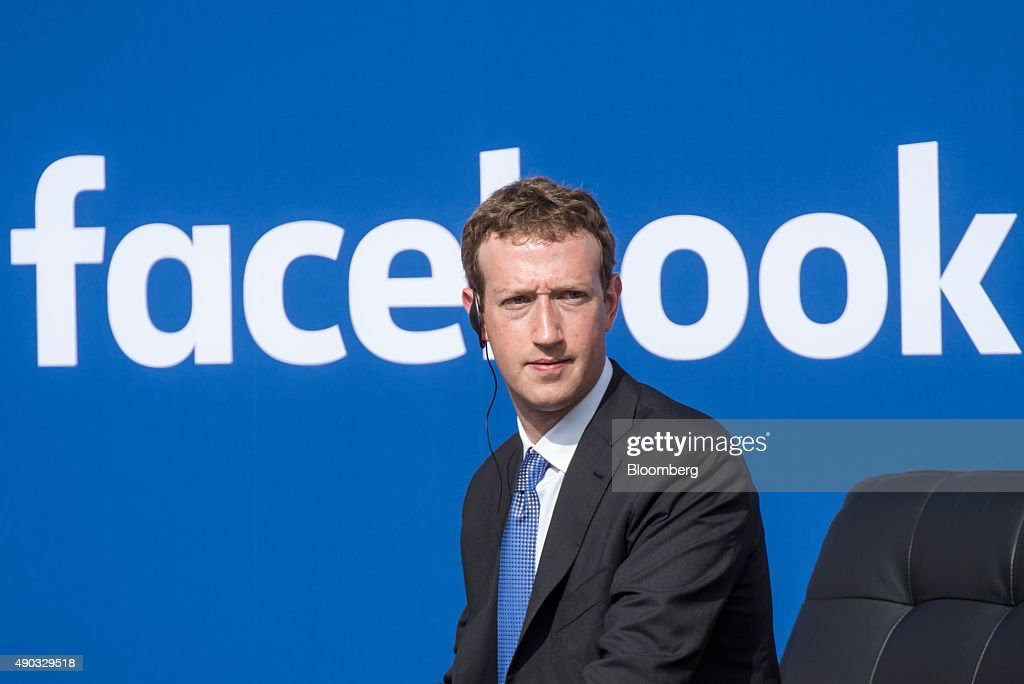 <a gi-track='captionPersonalityLinkClicked' href=/galleries/search?phrase=Mark+Zuckerberg&family=editorial&specificpeople=4841191 ng-click='$event.stopPropagation()'>Mark Zuckerberg</a>, chief executive officer of Facebook Inc., listens as Narendra Modi, India's prime minister, not pictured, speaks during a town hall meeting at Facebook headquarters in Menlo Park, California, U.S., on Sunday, Sept. 27, 2015. Prime Minister Modi plans on connecting 600,000 villages across India using fiber optic cable as part of his 'dream' to expand the world's largest democracy's economy to $20 trillion. Photographer: David Paul Morris/Bloomberg via Getty Images