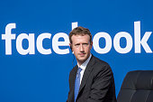 Mark Zuckerberg chief executive officer of Facebook Inc listens as Narendra Modi India's prime minister not pictured speaks during a town hall...