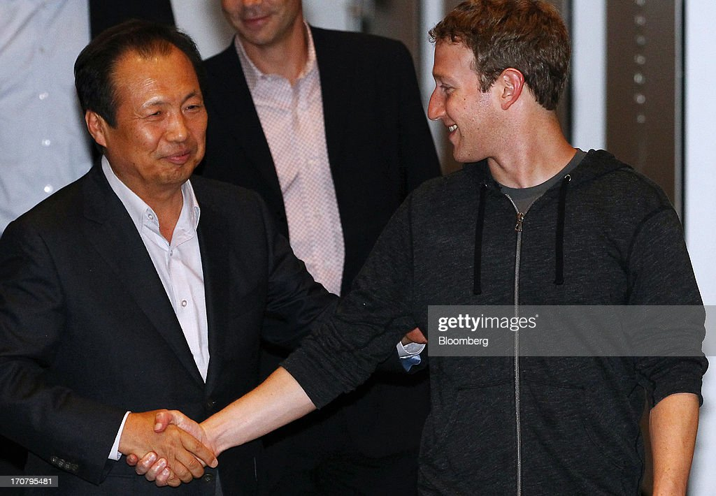 <a gi-track='captionPersonalityLinkClicked' href=/galleries/search?phrase=Mark+Zuckerberg&family=editorial&specificpeople=4841191 ng-click='$event.stopPropagation()'>Mark Zuckerberg</a>, chief executive officer of Facebook Inc., right, shakes hands with J.K. Shin, president of mobile communications for Samsung Electronics Co., as he leaves Samsung Electronic Co.'s Seocho office building in Seoul, South Korea, on Tuesday, June 18, 2013. Zuckerberg met Park Geun Hye, South Korea's president, in Seoul earlier today and discussed ways to realize Park's vision to foster a 'creative economy' and boost tech start-ups in Korea, Park's office said in a statement on its website. Photographer: SeongJoon Cho/Bloomberg via Getty Images