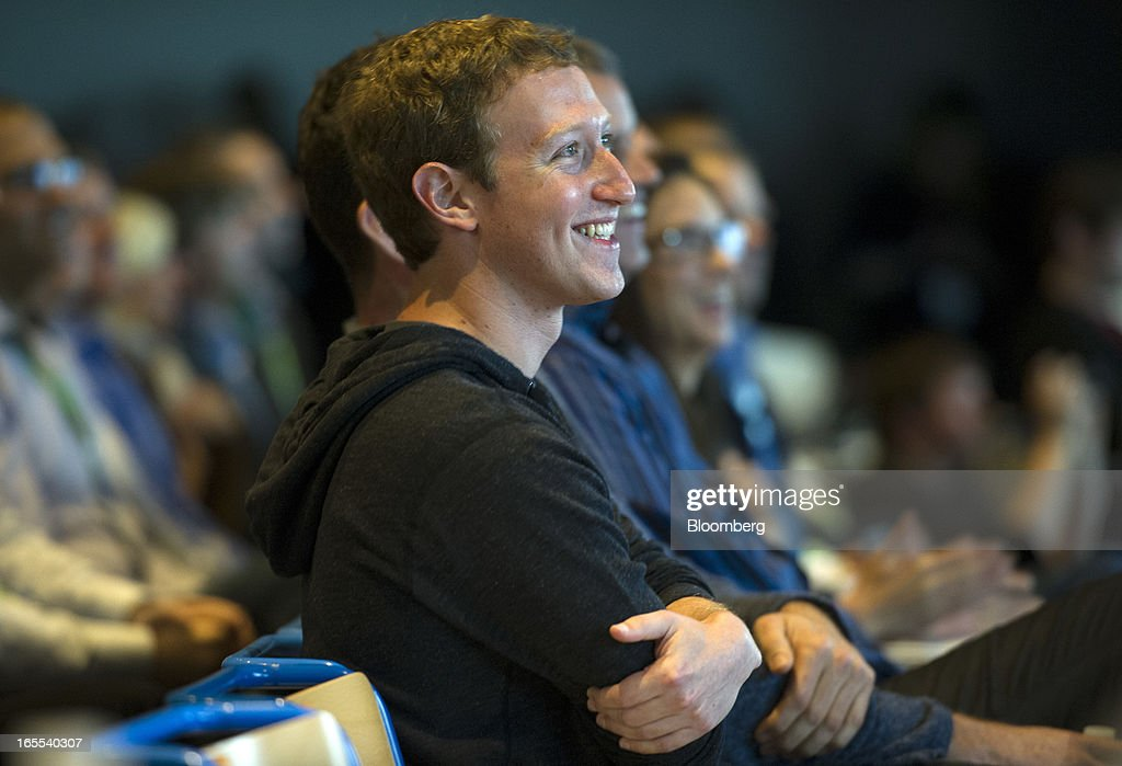 Mark Zuckerberg, chief executive officer of Facebook Inc., smiles while watching a presentation during an event in Menlo Park, California, U.S., on Thursday, April 4, 2013. Facebook unveiled smartphone software called Home that puts social-networking features front and center on a handset, stepping up efforts to boost sales of advertising on small screens. Photographer: David Paul Morris/Bloomberg via Getty Images