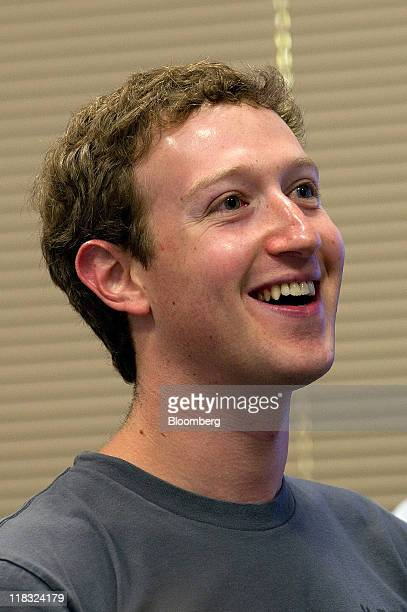 Mark Zuckerberg cofounder and chief executive officer of Facebook Inc watches a presentation during a press event at Facebook headquarters in Palo...