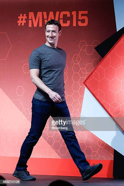 Mark Zuckerberg cofounder and chief executive officer of Facebook Inc arrives on stage for a keynote session at the Mobile World Congress in...