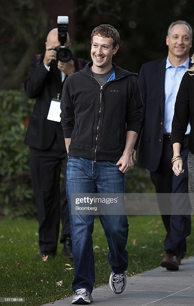 Mark Zuckerberg, founder and chief executive officer of Facebook Inc., arrives to speak during a news conference at Harvard University in Cambridge, Massachusetts, U.S., on Monday, Nov. 7, 2011. Zuckerberg said Apple Inc. co-founder Steve Jobs advised him on how to sharpen his company's focus and build the right management team for the world's largest social network. Photographer: Kelvin Ma/Bloomberg via Getty Images