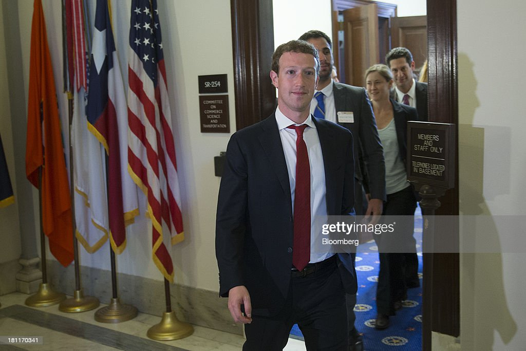 Mark Zuckerberg, founder and chief executive officer of Facebook Inc., leaves a meeting with members of the Senate Committee on Commerce, Science and Transportation in Washington, D.C., U.S., on Thursday, Sept. 19, 2013. Zuckerberg in April announced the formation of an advocacy group, Fwd.us, to push for more visas for skilled immigrant workers. He pressed that cause yesterday in a meeting with Senator Charles Schumer, a New York Democrat. Photographer: Andrew Harrer/Bloomberg via Getty Images