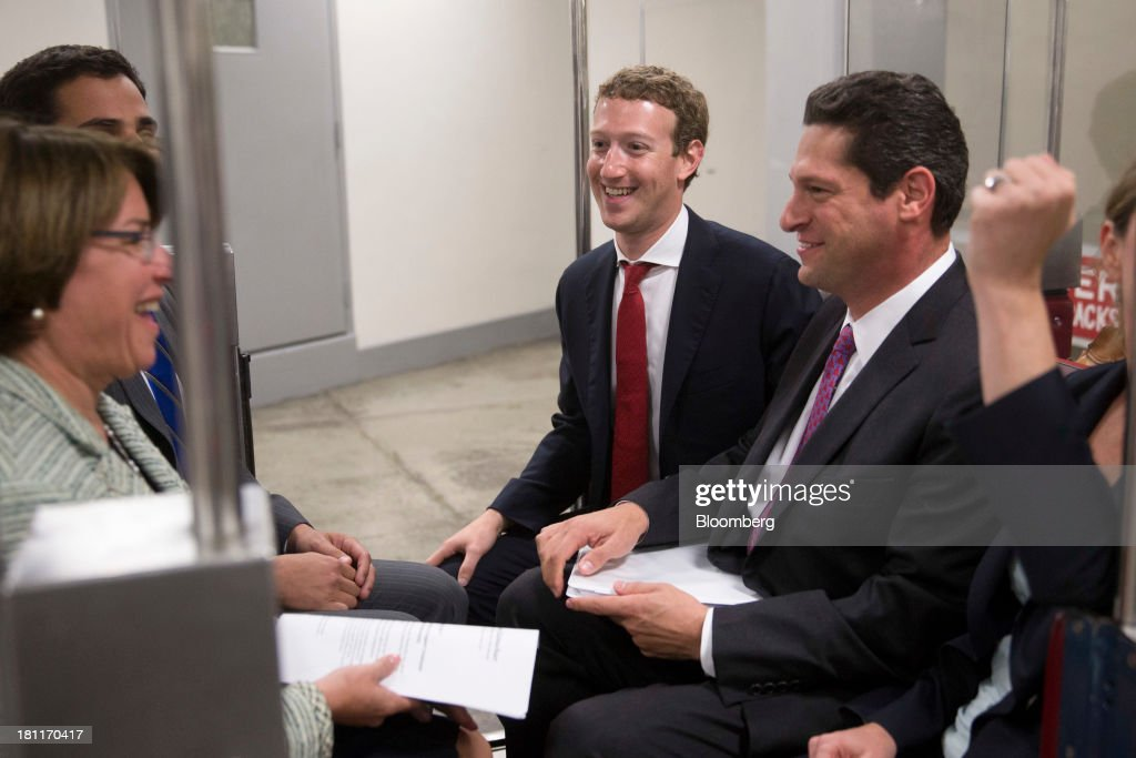 <a gi-track='captionPersonalityLinkClicked' href=/galleries/search?phrase=Mark+Zuckerberg&family=editorial&specificpeople=4841191 ng-click='$event.stopPropagation()'>Mark Zuckerberg</a>, founder and chief executive officer of Facebook Inc., center, rides on the Senate subway with Senator Amy Klobuchar, a Democrat from Minnesota, left, following a meeting with members of the Senate Committee on Commerce, Science and Transportation in Washington, D.C., U.S., on Thursday, Sept. 19, 2013. Zuckerberg in April announced the formation of an advocacy group, Fwd.us, to push for more visas for skilled immigrant workers. He pressed that cause yesterday in a meeting with Senator Charles Schumer, a New York Democrat. Photographer: Andrew Harrer/Bloomberg via Getty Images