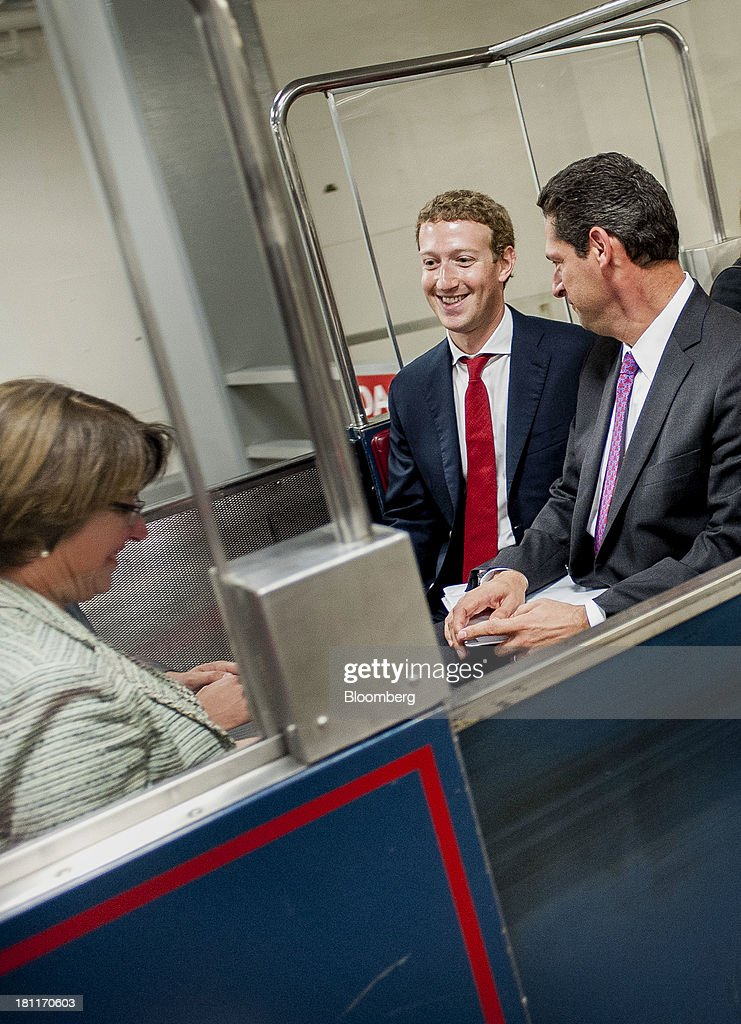 Mark Zuckerberg, founder and chief executive officer of Facebook Inc., center, rides on the Senate subway with Senator Amy Klobuchar, a Democrat from Minnesota, left, following a meeting with members of the Senate Committee on Commerce, Science and Transportation in Washington, D.C., U.S., on Thursday, Sept. 19, 2013. Zuckerberg in April announced the formation of an advocacy group, Fwd.us, to push for more visas for skilled immigrant workers. He pressed that cause yesterday in a meeting with Senator Charles Schumer, a New York Democrat. Photographer: Pete Marovich/Bloomberg via Getty Images