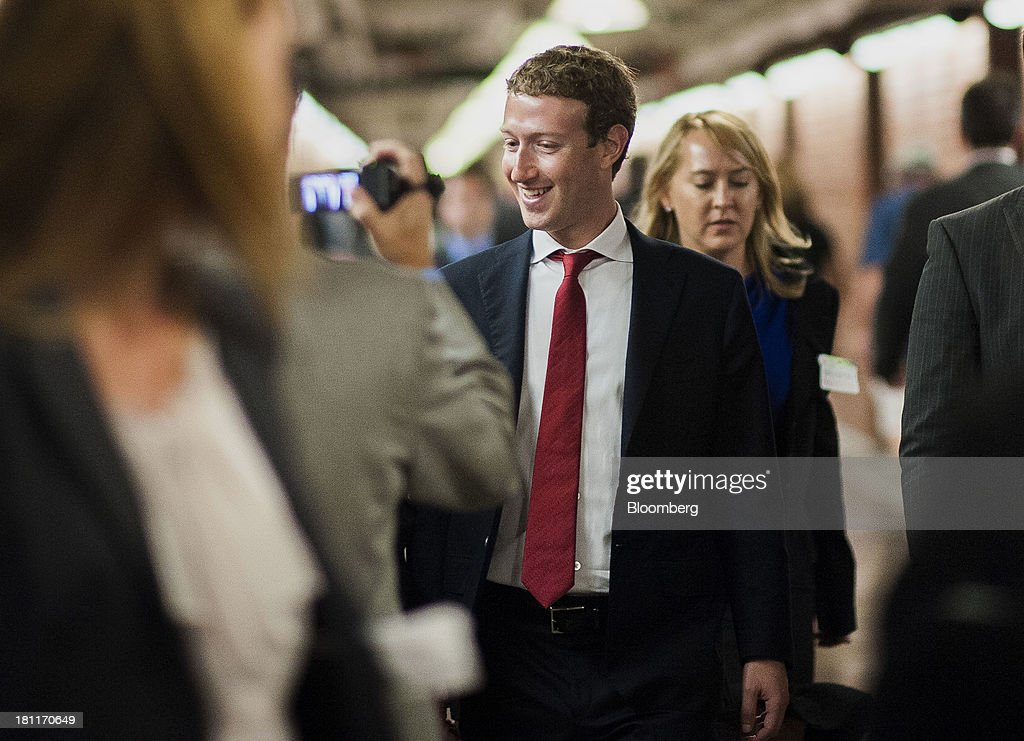<a gi-track='captionPersonalityLinkClicked' href=/galleries/search?phrase=Mark+Zuckerberg&family=editorial&specificpeople=4841191 ng-click='$event.stopPropagation()'>Mark Zuckerberg</a>, founder and chief executive officer of Facebook Inc., center, walks towards the Senate subway following a meeting with members of the Senate Committee on Commerce, Science and Transportation in Washington, D.C., U.S., on Thursday, Sept. 19, 2013. Zuckerberg in April announced the formation of an advocacy group, Fwd.us, to push for more visas for skilled immigrant workers. He pressed that cause yesterday in a meeting with Senator Charles Schumer, a New York Democrat. Photographer: Pete Marovich/Bloomberg via Getty Images