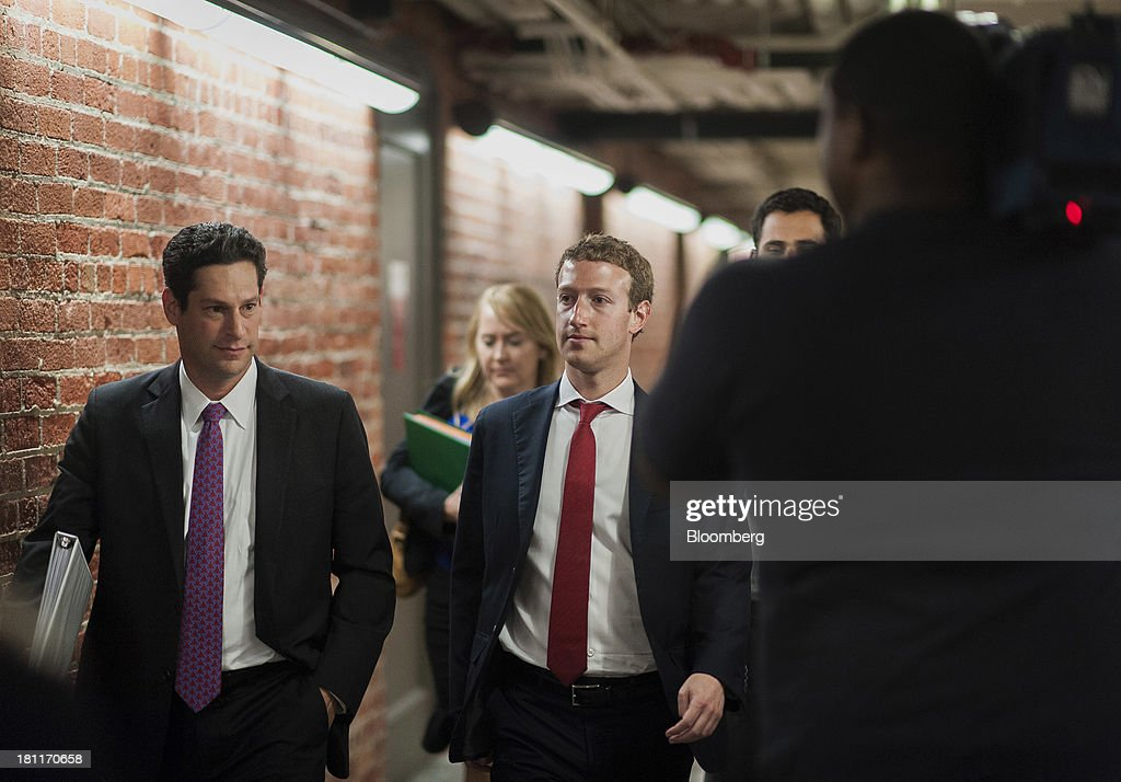 Mark Zuckerberg, founder and chief executive officer of Facebook Inc., center, walks towards the Senate subway following a meeting with members of the Senate Committee on Commerce, Science and Transportation in Washington, D.C., U.S., on Thursday, Sept. 19, 2013. Zuckerberg in April announced the formation of an advocacy group, Fwd.us, to push for more visas for skilled immigrant workers. He pressed that cause yesterday in a meeting with Senator Charles Schumer, a New York Democrat. Photographer: Pete Marovich/Bloomberg via Getty Images