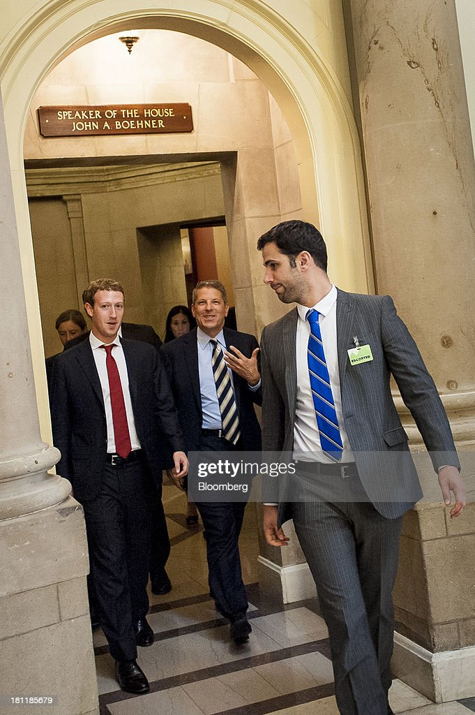 Mark Zuckerberg, founder and chief executive officer of Facebook Inc., left, leaves House Speaker John Boehner's office after a meeting with members of the House Republican Leadership in Washington, D.C., U.S., on Thursday, Sept. 19, 2013. Zuckerberg in April announced the formation of an advocacy group, Fwd.us, to push for more visas for skilled immigrant workers. Photographer: Pete Marovich/Bloomberg via Getty Images