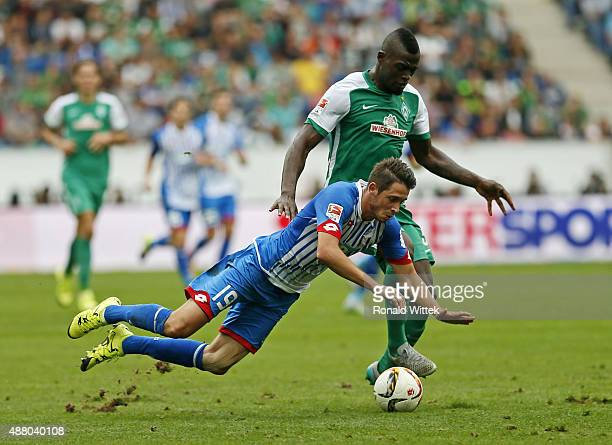 MarkAlexander Uth of Hoffenheim and Assani Lukimya of Bremen compete for the ball during the Bundesliga match between 1899 Hoffenheim and SV Werder...