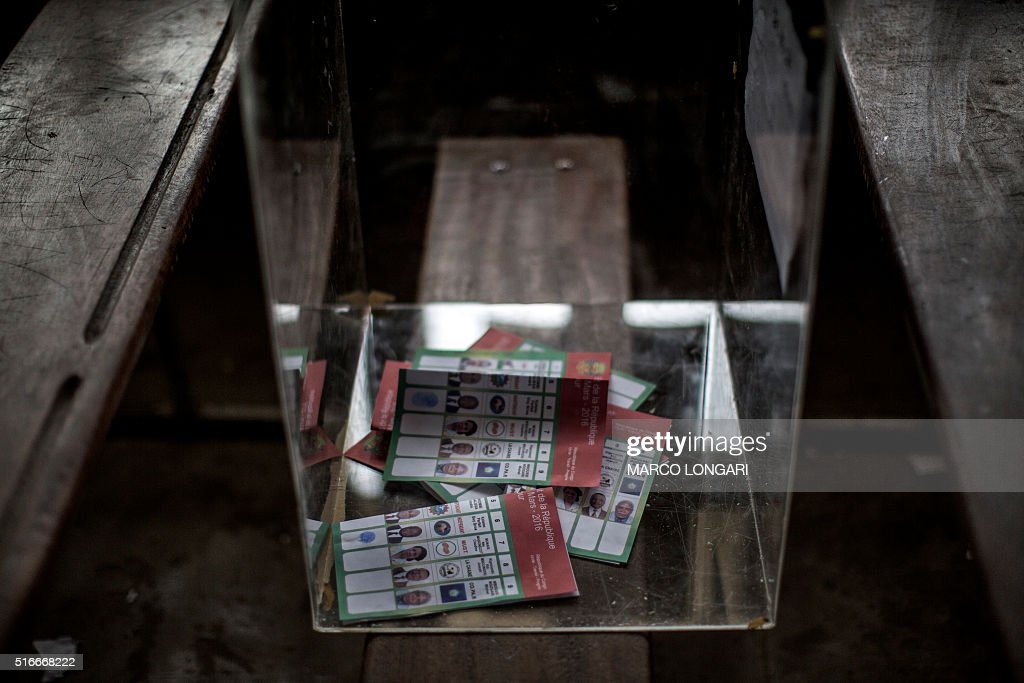 Marked ballot papers are seen in the ballot box at a polling station during presidential elections in Makelele Brazzaville on March 20 2016 Congo...