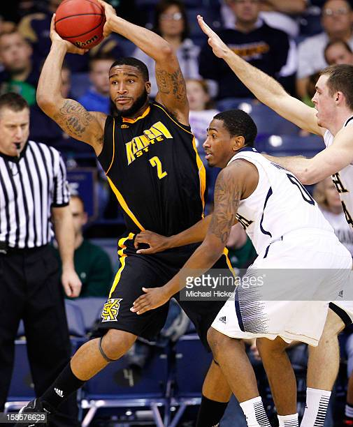 Markeith Cummings of the Kennesaw State Owls looks for a teammate to pass the ball to as Eric Atkins of the Notre Dame Fighting Irish and Scott...