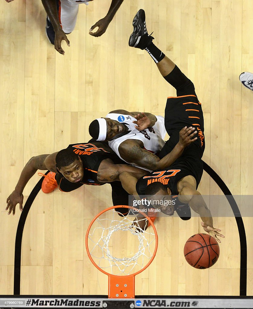 Markel Brown #22 and <a gi-track='captionPersonalityLinkClicked' href=/galleries/search?phrase=Marcus+Smart&family=editorial&specificpeople=7887125 ng-click='$event.stopPropagation()'>Marcus Smart</a> #33 of the Oklahoma State Cowboys go for the ball against Gary Bell, Jr. #5 of the Gonzaga Bulldogs during the second round of the 2014 NCAA Men's Basketball Tournament at Viejas Arena on March 21, 2014 in San Diego, California.