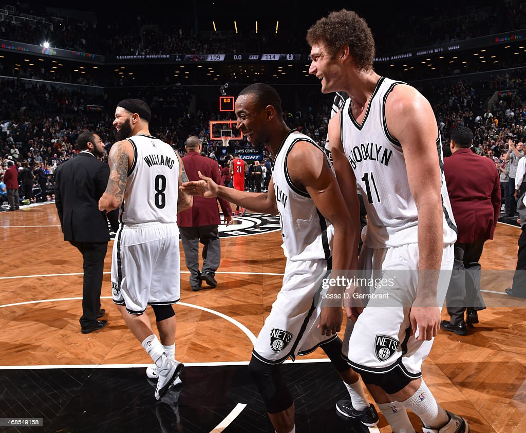 Markel Brown #22 , Brook Lopez #11 and Deron Williams #8 of the Brooklyn Nets all smile after the win against the Toronto Raptors at Barclays Center on April 3, 2015 in Brooklyn, New York