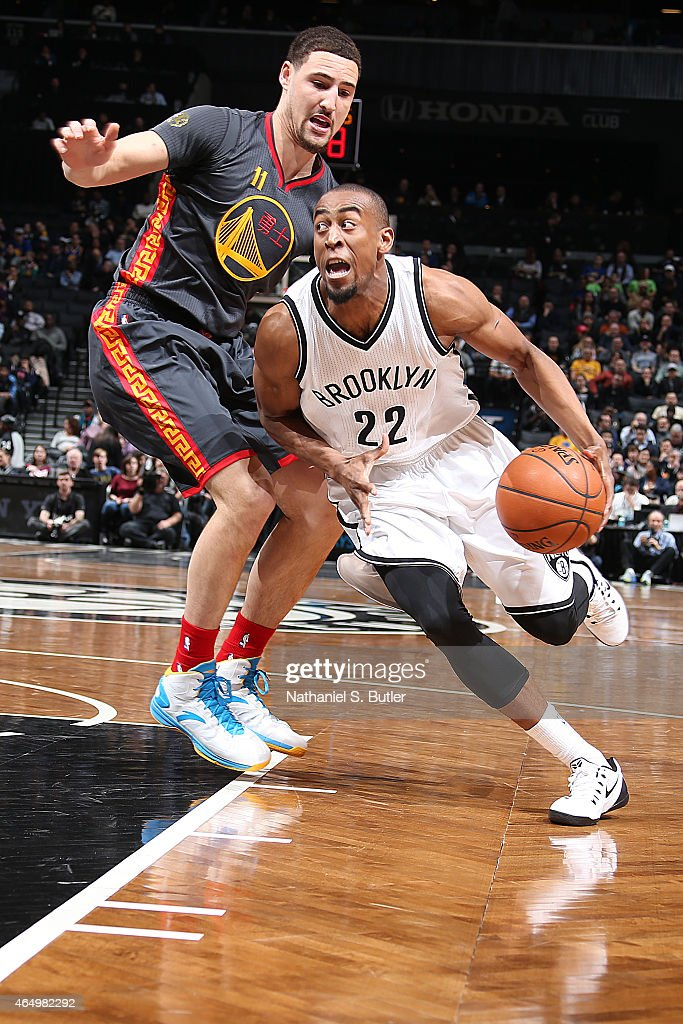 Markel Brown #22 of the Brooklyn Nets handles the ball against Klay Thompson #11 of the Golden State Warriors during the game on March 2, 2015 at Barclays Center in Brooklyn, New York.