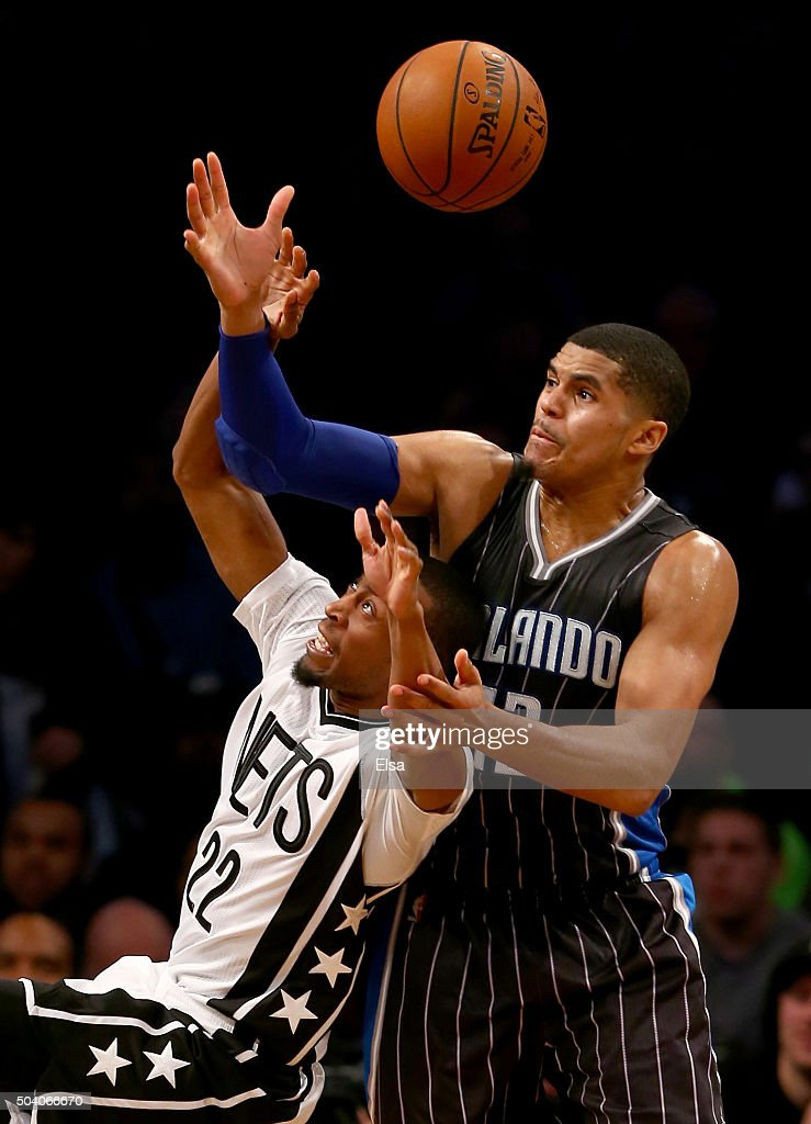 Markel Brown #22 of the Brooklyn Nets loses control of the ball as Tobias Harris #12 of the Orlando Magic defends on January 8,2016 at the Barclays Center in the Brooklyn borough of New York City.The Orlando Magic defeated the Brooklyn Nets 83-77.NOTE