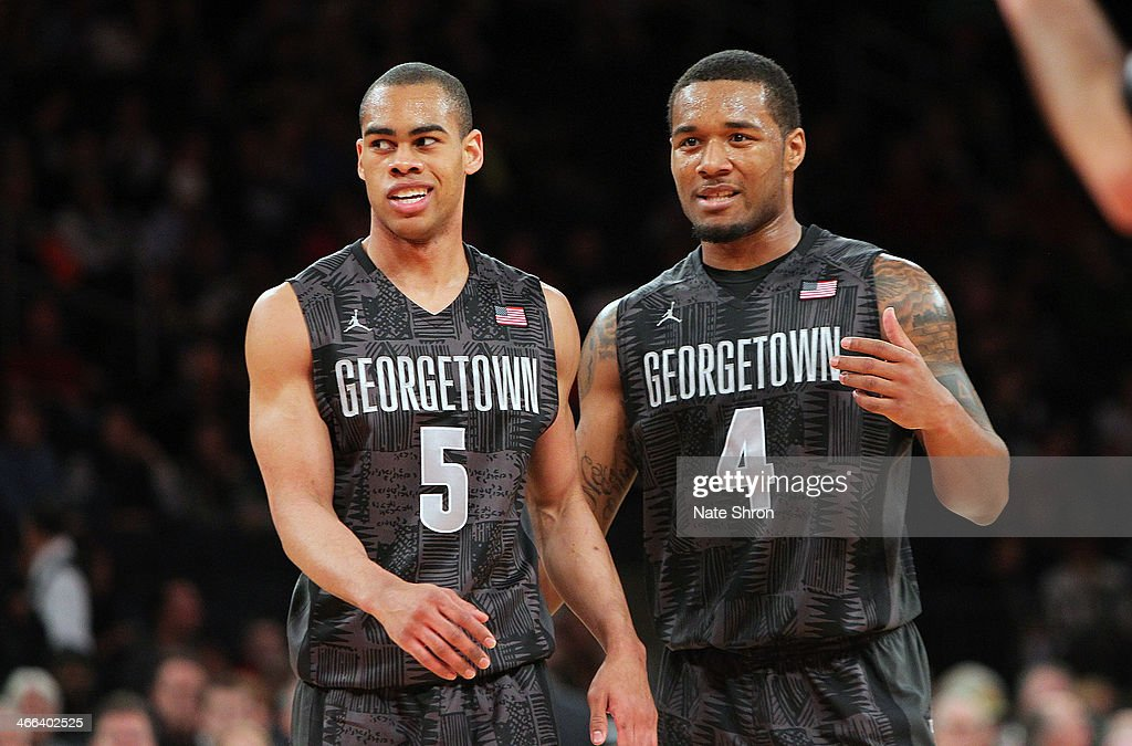 Markel Starks #5 and D'Vauntes Smith-Rivera #4 of the Georgetown Hoyas cheer on the court during their win over the Michigan State Spartans during the game at Madison Square Garden on February 1, 2014 in New York City.