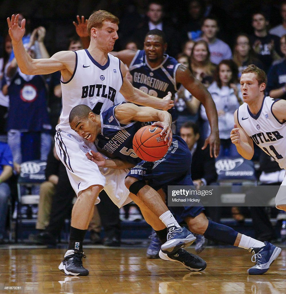Markel Starks #5 of the Georgetown Hoyas dribbles the ball and collides with Erik Fromm #4 of the Butler Bulldogs at Hinkle Fieldhouse on January 11, 2014 in Indianapolis, Indiana. Georgetown defeated Butler 70-67.