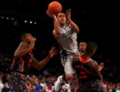 Markel Starks of the Georgetown Hoyas drives for a shot attempt in the second half against Justin Jackson of the Cincinnati Bearcats during the...