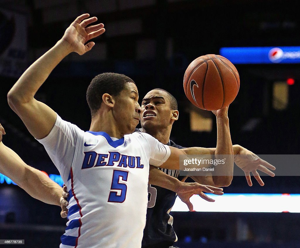 Markel Starks #5 of the Georgetown Hoyas is fouled by Billy Garrett Jr. #5 of the DePaul Blue Demons at the Allstate Arena on February 3, 2014 in Rosemont, Illinois.