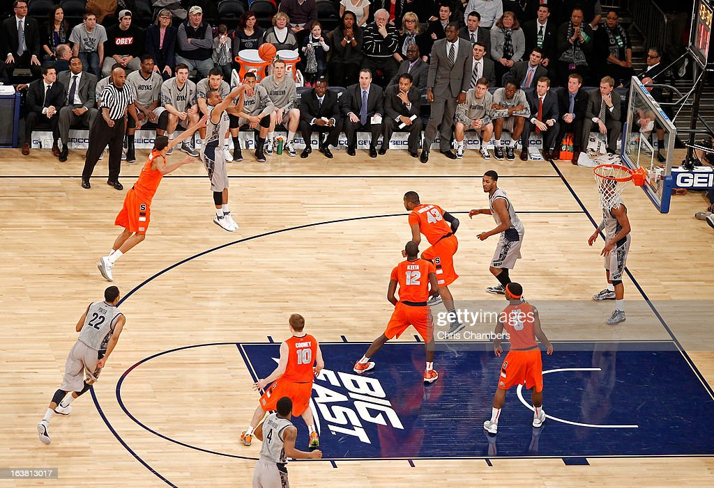 Markel Starks #5 of the Georgetown Hoyas makes a 3-point shot against Michael Carter-Williams #1 of the Syracuse Orange during the semifinals of the Big East Men's Basketball Tournament at Madison Square Garden on March 15, 2013 in New York City.