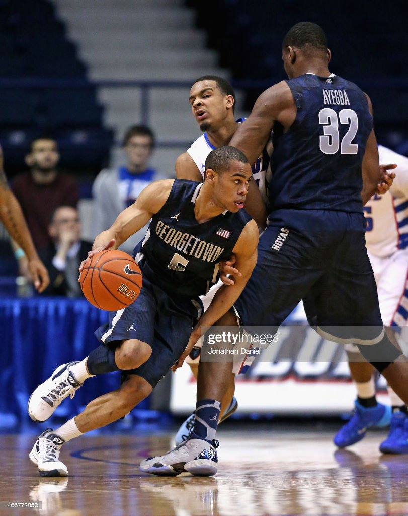 Markel Starks #5 of the Georgetown Hoyas moves around a pick set by teammate Moses Ayegba #32 on Brandon Young #20 of the DePaul Blue Demons at the Allstate Arena on February 3, 2014 in Rosemont, Illinois. Georgetown defeated DePaul 71-59.