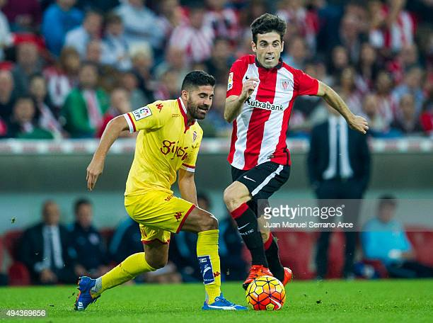 Markel Susaeta of Athletic Club duels for the ball with Carlos Carmona of Real Sporting de Gijon during the La Liga match between Athletic Club and...